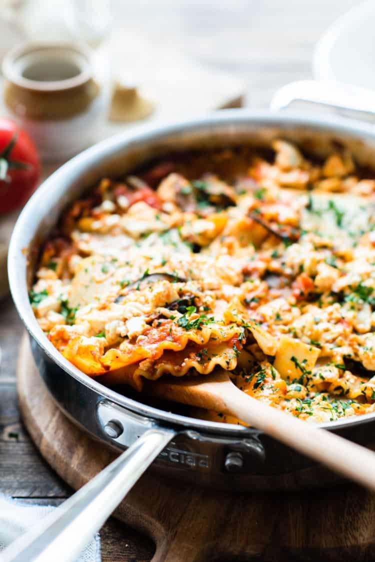 Eggplant skillet lasagna in a stainless steel deep-sided pan.