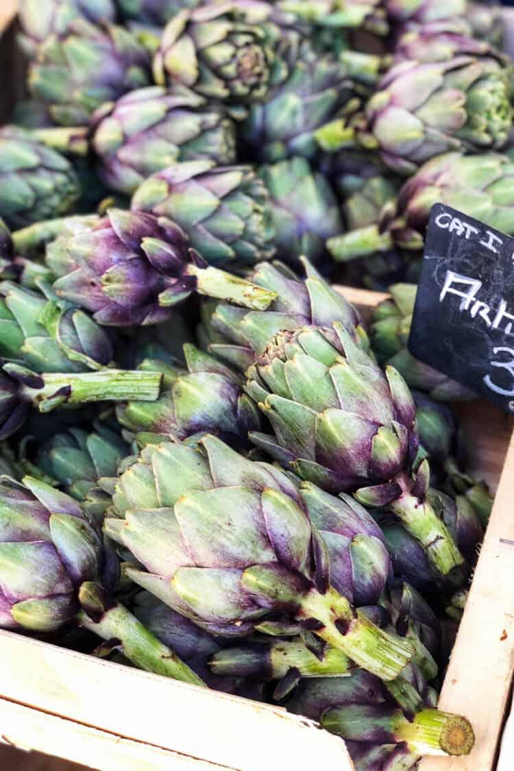 Fresh artichokes at Marché aux Fleurs Cours Saleya, Nice, France.