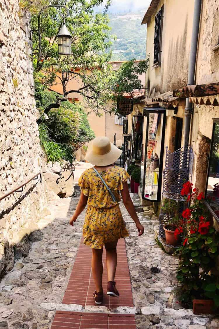 Girl walking through the medieval town of Èze, France.
