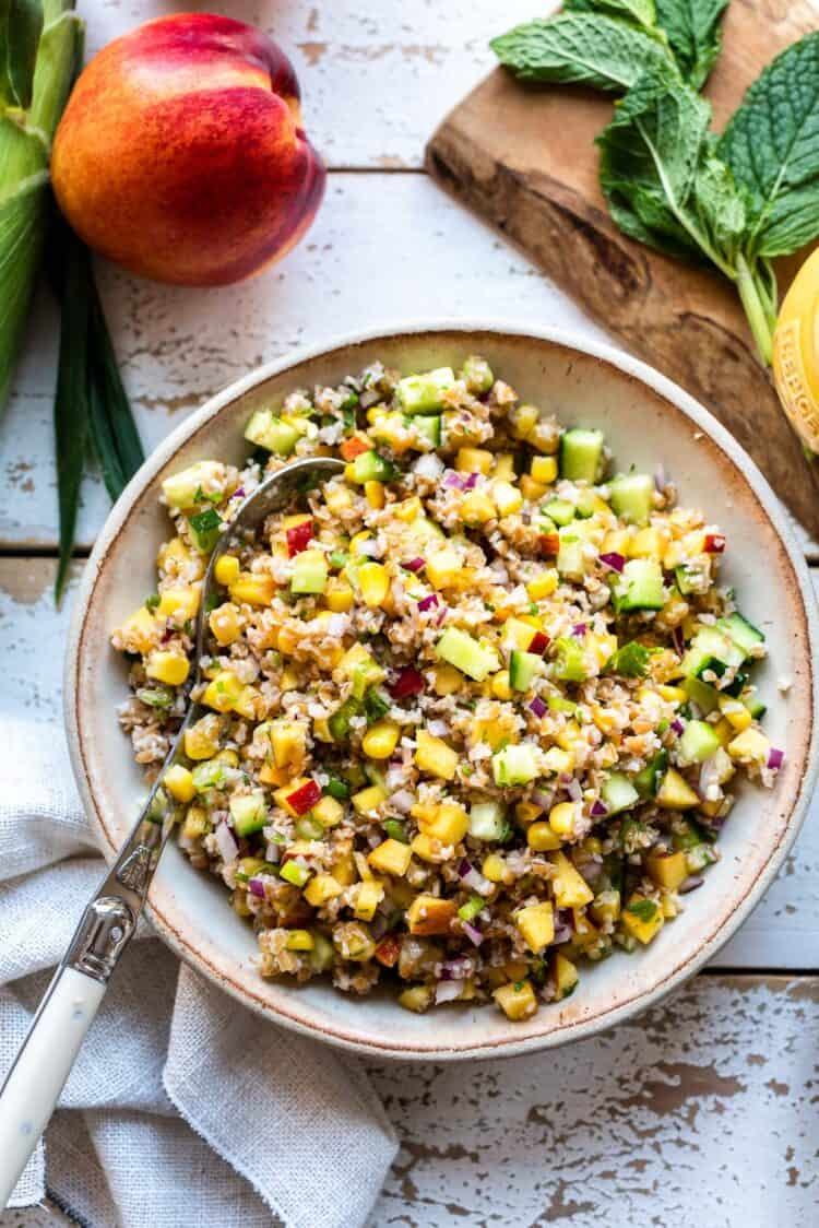 Summer Corn and Nectarine Tabbouleh in a cream colored serving dish.