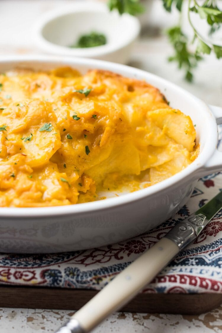 Scalloped Potatoes plant-based and dairy-free made with butternut squash in a white, oval baking dish.