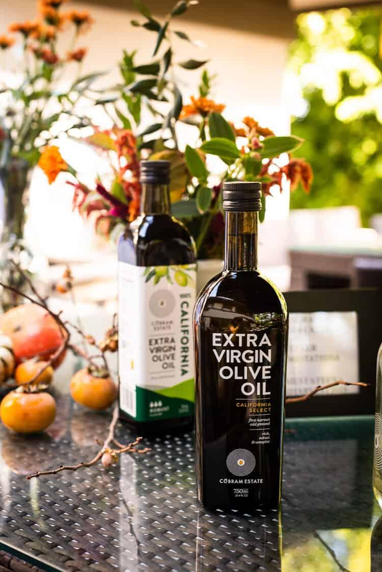 Bottle of Cobram Estate Olive Oil on a table.