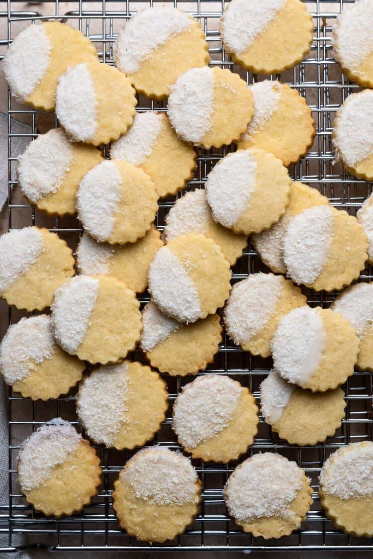 Coconut Shortbread Cookies with coconut glaze and shredded coconut on a wire rack.