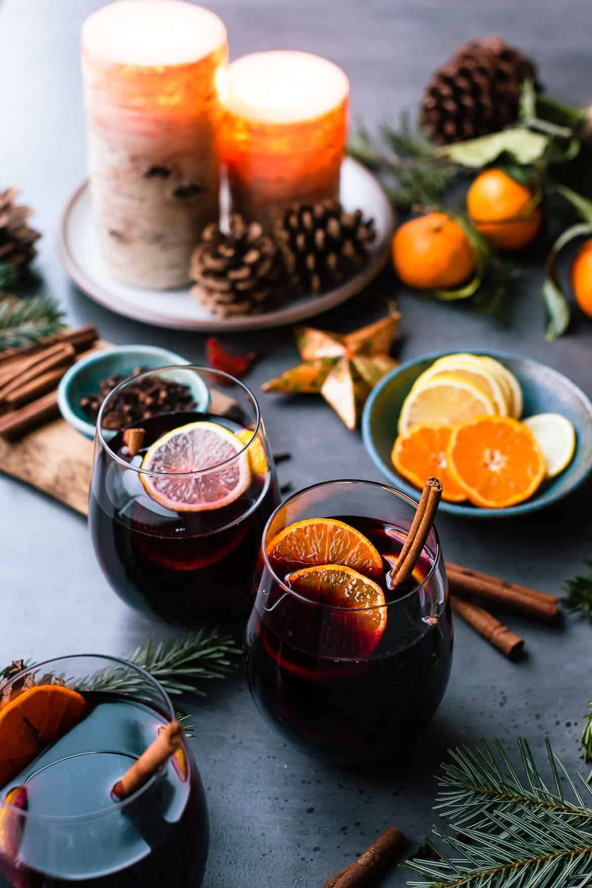 Glasses of mulled wine with citrus and spices for Christmas.