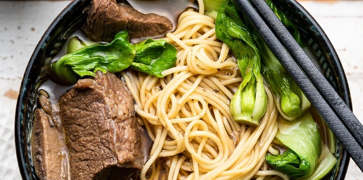Instant Pot Short Rib Ramen in a ramen bowl with bok choy.