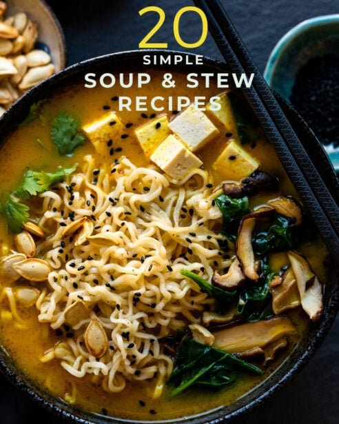 Spicy Pumpkin Ramen in a black bowl, one of 20 simple soup and stew recipes to stay cozy.