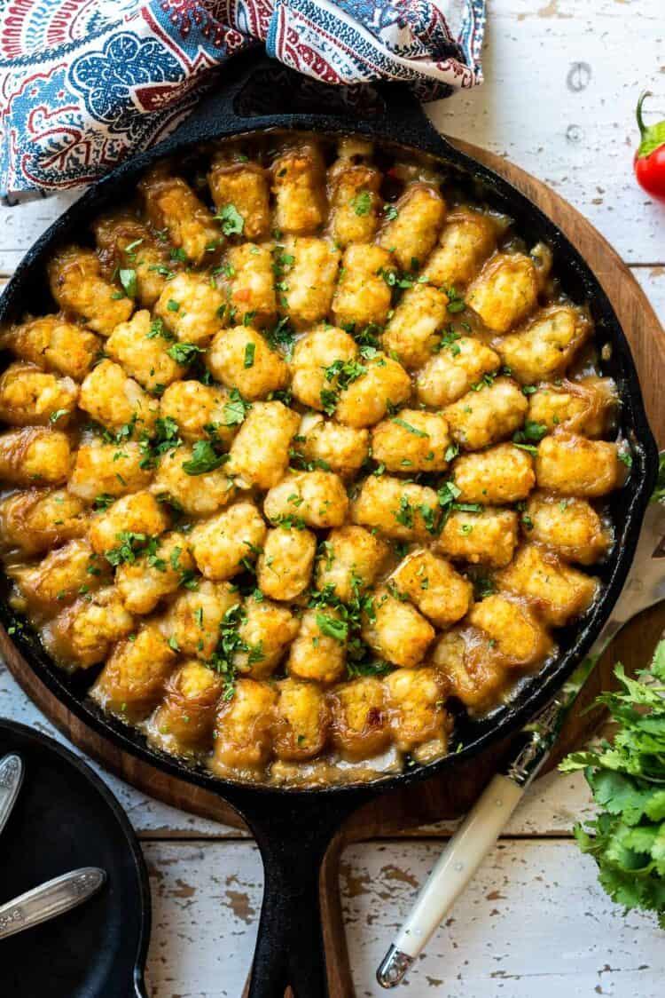 Vegetarian Tater Tot Casserole in a cast iron pan.