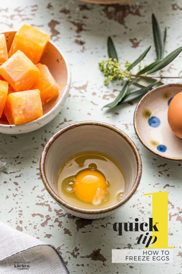 A raw egg in a small brown bowl next to a bowl of frozen egg cubes.