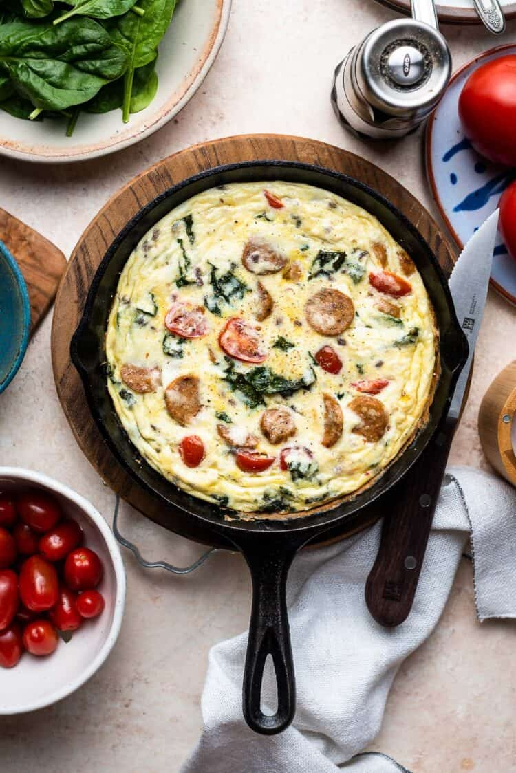 Italian Sausage and Kale Frittata in a cast iron skillet.