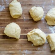 Dividing Challah dough into sections for baking.