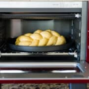 Sweet Potato Challah loaf in an oven.