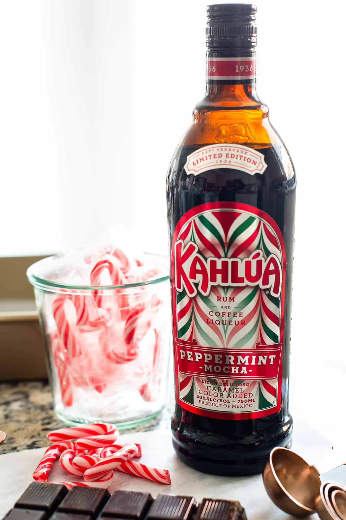 A bottle of Kahlúa Peppermint Mocha, surrounded by candy canes.