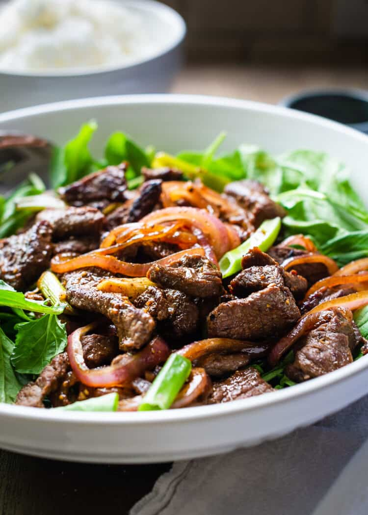 Shaking Beef Stir Fry served over greens.