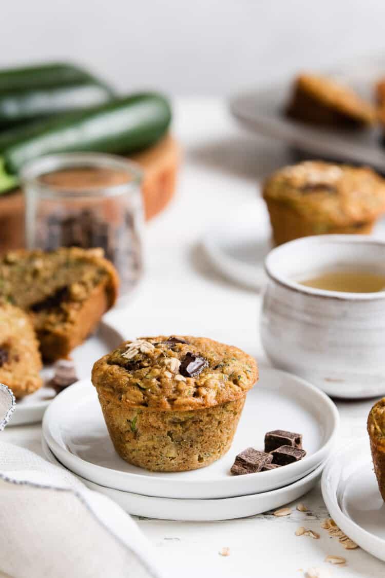 Zucchini Oat Chocolate Chunk Muffins on small white plates.