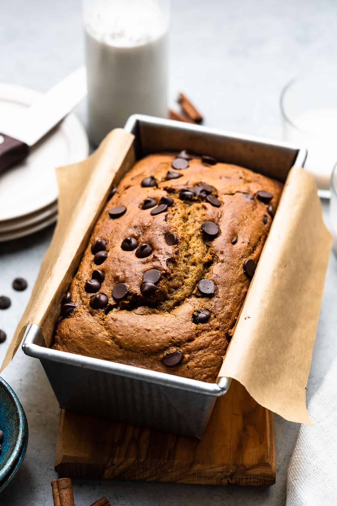 A loaf pan of Chocolate Chip Pumpkin bread, topped with chocolate chips.