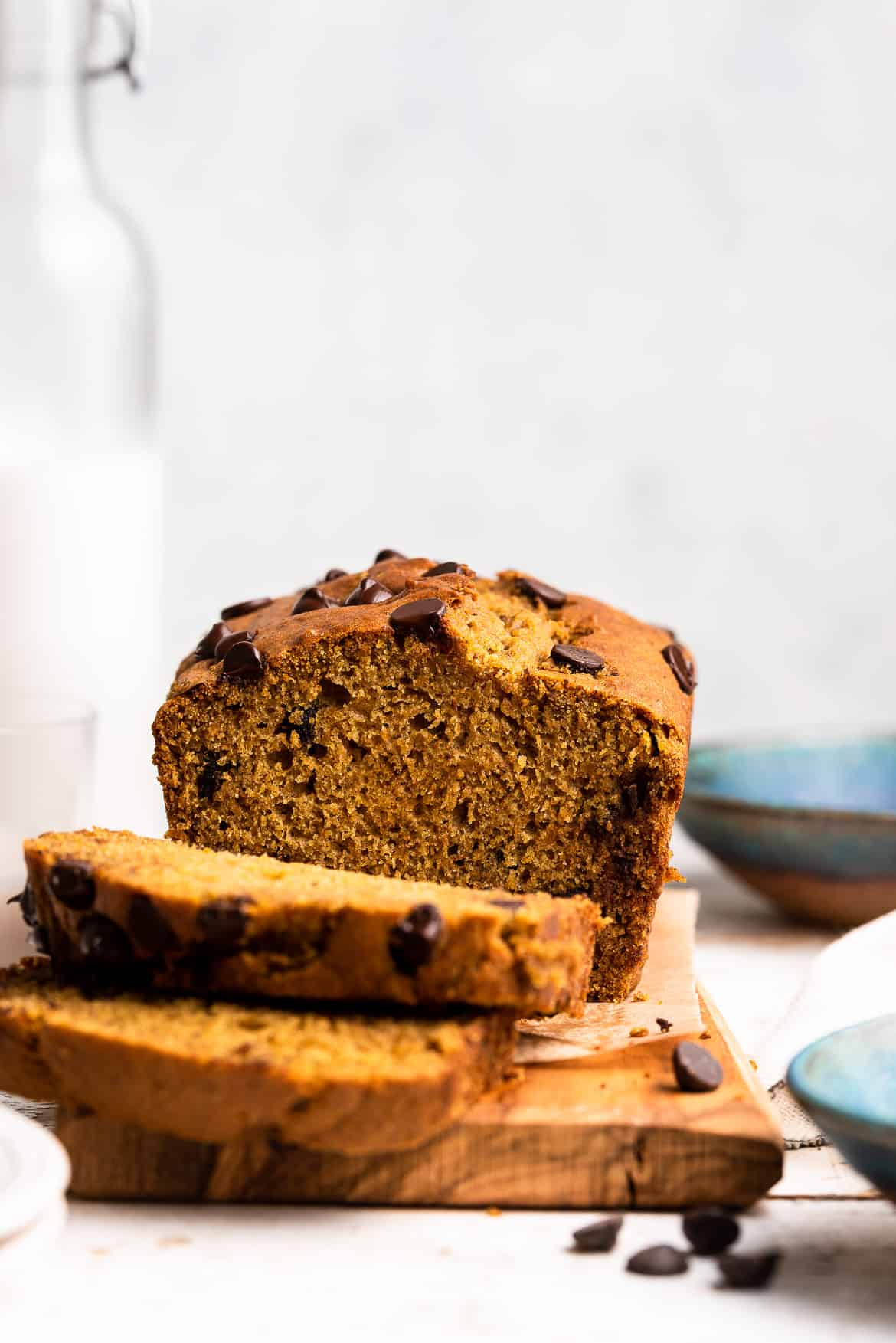 Slices of homemade pumpkin bread topped with chocolate chips.