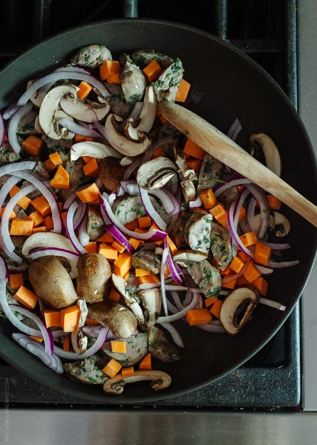 Cooking vegetables in a cast iron pan.