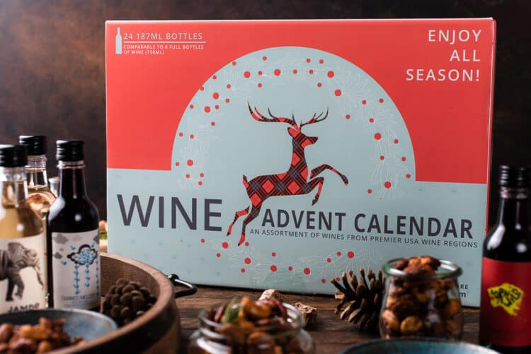 Wine Advent Calendar on a wooden table with holiday spiced nuts.
