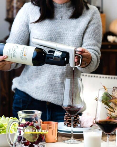 Pouring a glass of wine is one of Five Little Things I loved the week of November 21, 2020, including Thanksgiving traditions, gingerbread houses with a twist, good humans, and more.
