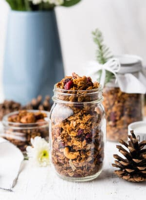 Gingerbread Granola in a glass mason jar.