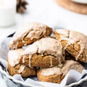 Gingerbread Scones stacked on a blue baking dish