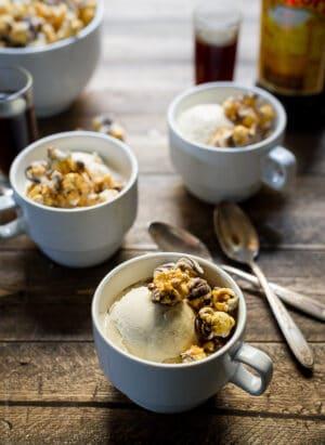 Three mugs filled with ice cream, espresso, and caramel popcorn for Caramel Corn Kahlúa Affogatos.