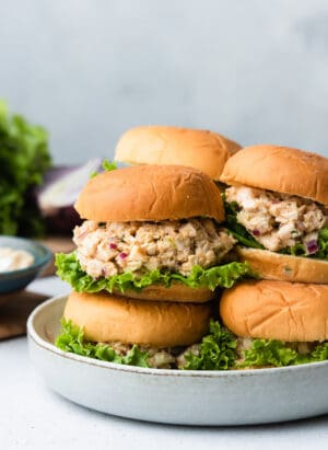 Stack of hummus chicken salad sliders in a grey dish.