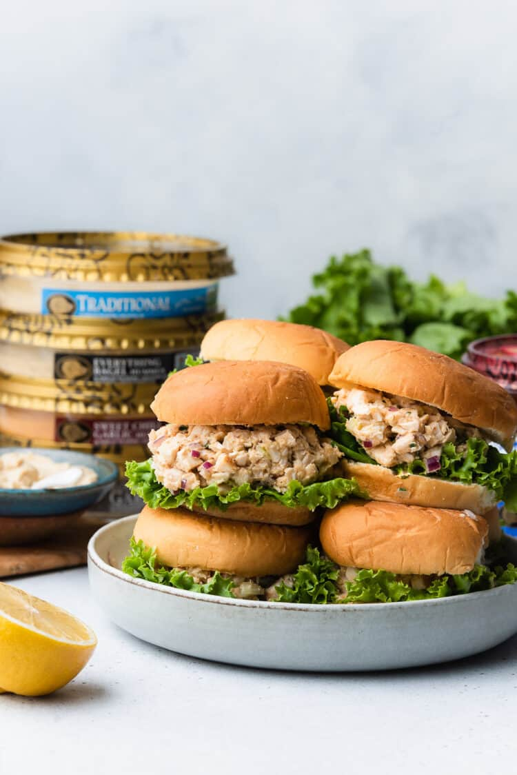 Stack of Hummus Chicken Salad Sliders with Boar's Head Hummus in the background.