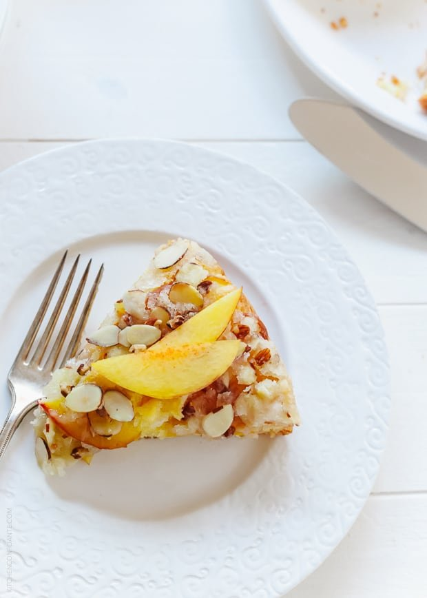 A slice of Nectarine Crumb Cake topped with nectarine slices.