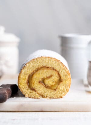 Pianono (Filipino Swiss roll) on a white marble cutting board.