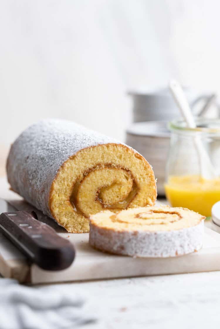 Sliced Pianono (Filipino Swiss roll) on a white marble cutting board.