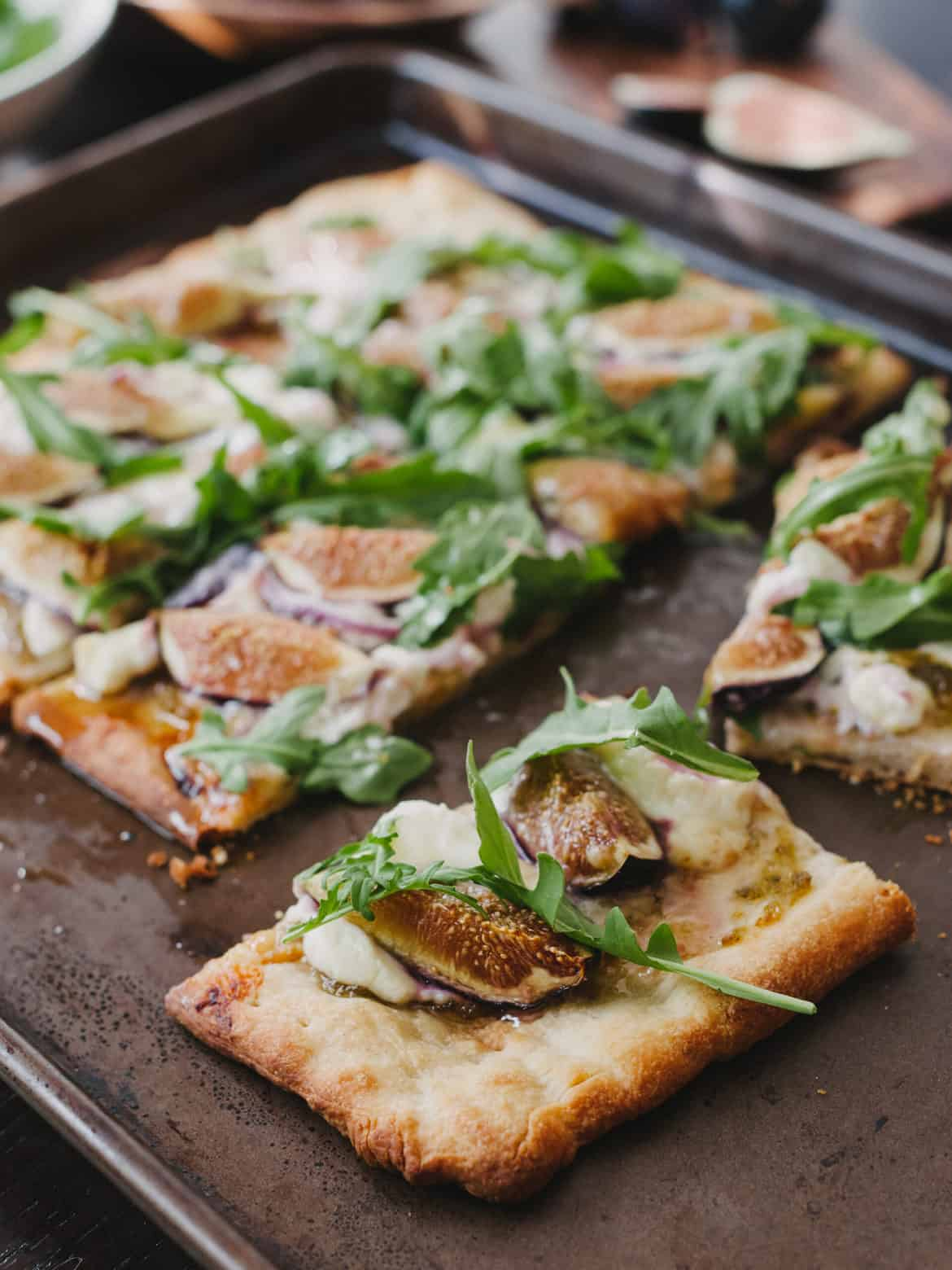 Slices of Fig, Jalapeño Jam & Blue Cheese Pizza on a baking sheet.