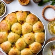 Pesto Pull-Apart Rolls in a white baking dish.