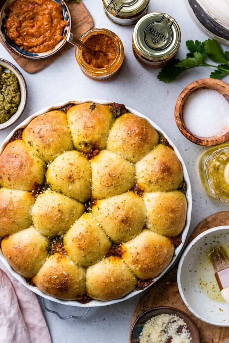 Pesto Pull-Apart Rolls in a white baking dish.