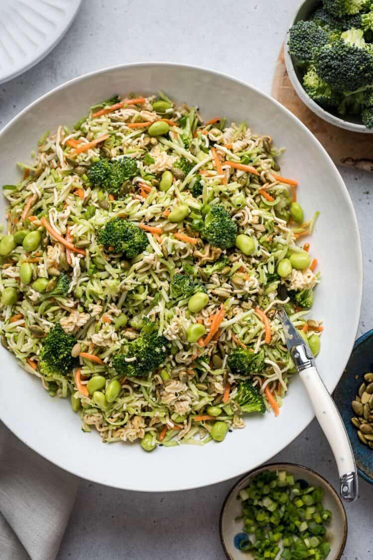 Broccoli Slaw with Ramen in a white bowl.