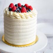Birthday cake on a cake stand.