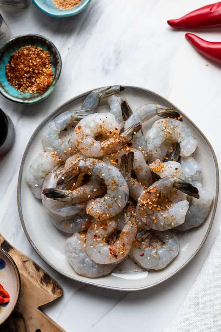Shrimp seasoned with Thai seasoning on a plate.